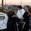 """Post crash, the Kevin Harvick, Inc., Hornaday Team works on Camping World Truck #33 after the """"Big One"""" at Talladega as NASCAR officials, fans, and others look on."""