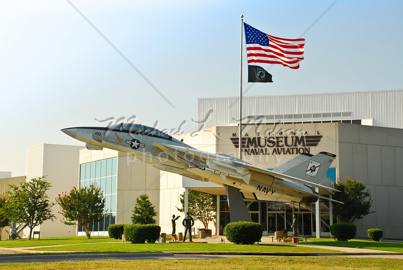 """font size=4>Week 47  (Mike) -<br> """"Tomcat"""" <font size=3> </i></b> This Grumman F-14A Tomcat sits proudly in front of the National Museum of Naval Aviation in Pensacola, FL. The F-14A is a variable-sweep wing aircraft and was the Navy's air superiority supersonic fighter from 1974 to 2006. The F-14A fighters were retired in 2006 as they have been  replaced by the Boeing F/A-18E/F Super Hornet  <br>Tech info: Program mode, daylight white balance,  f7.1, at 1/180th seconds. Multi Metering at ISO 100.  Colors, contrast, and levels adjusted in Photoshop Light Room 2 and Photoshop Elements."""