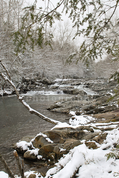 """<font size=4>Week 36  (Mike) -<br>""""Little River"""" <font size=3>It snowed last weekend in Gatlinburg, TN.  and Carol and I certainly enjoyed it. This beautiful river is located just off of Hwy. 321. Turn into the entrance of the Greenbriar Station of the National Park.  It is funny, this photo was taken on Sunday in the snow. However on the day before I had just photographed a newlywed couple in this exact spot and it was 65 degrees. <font size =3> <br>Tech info: Manual mode, Auto white balance,  f16, at 1/50th seconds. Multi Metering at ISO 200.  Contrast, and levels adjusted in Photoshop Light Room 2 and Photoshop Elements."""