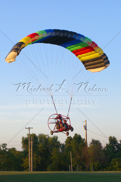 """<font size=4> Week 8 (Carol) - """"Evening Flight"""" <font size=3> Nothing like flying up to 500 feet above the earth in this """"glorified go-cart-swamp boat-parachute"""" (technically known as a paraplane)especially when your pilot shuts off the engine. They really are fun to fly once you muster the courage."""