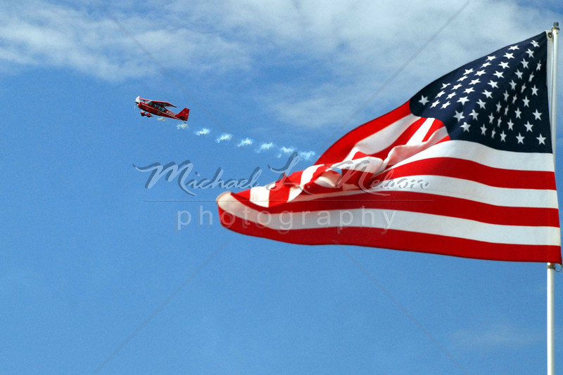 """<font size=4>Week 17  (Mike) -<br>""""Wings of Freedom"""" <font size=3> I took this photograph a few weeks ago at The Bessemer Air Show. I was on a shooting assignment with my Color II photography class. I got a lot of nice photos that day, but this one stands out as a reminder of how blessed we are to live in a country where everyone is free to pursue their dreams. Freedom to become a doctor, lawyer, teacher, photographer, or a stunt pilot. We truly are blessed.  <br>Tech info: Manual mode, daylight white balance,  f9.0, at 1/320th second using a Polarizer. Matrix Metering at ISO 400."""