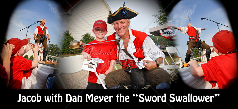 """font size=4>Week 51  (Mike) -<br> """"Jacob and Dan"""" <font size=3> </i></b> My nephew Jacob really enjoyed watching the performance of world famous sword swallower Dan Meyer at the American Village in Montevallo, AL. Dan is one of only a handful of true sword swallowers  (not a trick - confirmed by x-rays) in the world. Jacob was excited to meet him and get his autograph after the show.   <br>Tech info: Program mode, auto white balance,  f9.0, at 1/320th seconds, Multi Metering at ISO 200. Colors, contrast, levels, adjusted in Photoshop Light Room 2 Merge created in Photoshop Elements."""
