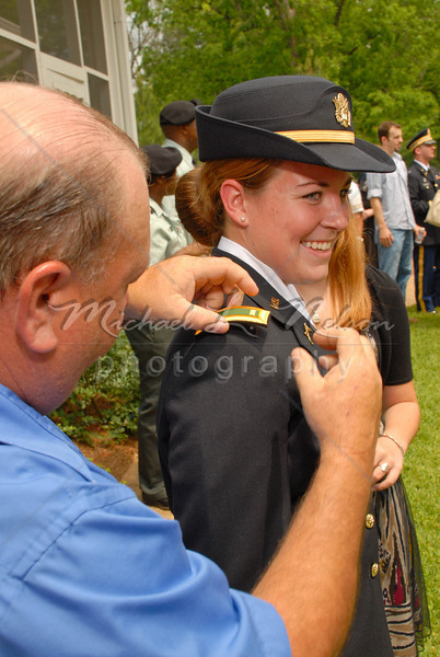 """font size=4>Week 45  (Mike) -<br> """"Pinning Practice"""" <font size=3> </i></b> It's Graduation Day at Marion Military Institute and cadet Rebecca Bathrick is one of the graduates. While others are enjoying the food and festivities at the reception, Rebecca's father is taking a moment to practice pinning """"Officer Bars"""" onto her shoulders. He is doing this because immediately following this reception there will be an """"Officer's Commissioning Ceremony."""" In the graduating class of 2009 there were 54 graduating cadets and 34 of the graduates are about to become commissioned officers. Rebecca will be one of  of those 34. As a part of the Commissioning Ceremony the cadet is allowed to choose who they want to come to the platform and pin their """"Bars"""" on them as they receive their commission. Rebecca has chosen her mother and father.  <br>Tech info: Manual mode, auto white balance,  f9.0, at 1/125th seconds. Spot Metering at ISO 200.  Flash with Nikon SB 800 in TTL mode. Colors, contrast, and levels adjusted in Photoshop Light Room 2 and Photoshop Elements."""