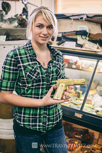 Chicago Bobs Gun Shop - Augusta WI - Daughter Holds Her Gold Plated Gun