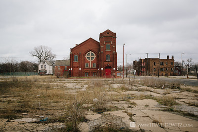 gary_in_large_church_and_cross_vacant_lot_6290
