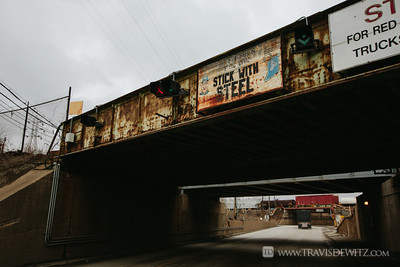 gary_in_stick_with_steel_sign_railroad_bridge_6438