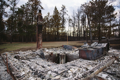 germann_road_fire_burnt_cabin_standing_chimney
