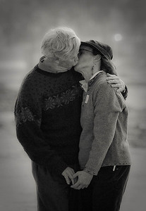 """Gimme a Smoocth This photograph won 2nd  place in Poly Photo Clubs Project called """"Emotion""""  I wish I would have given this couple my card, I have no idea who they are. They were walking hand and hand on the beach as I was shooting some surfers... July 2009 ©JLCramerPhotography 2009"""