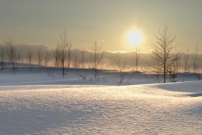 Sunset on snow glade
