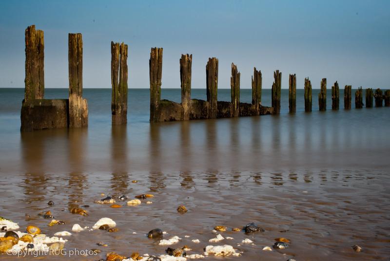 Old timber wave break, Minnis Bay, Kent.