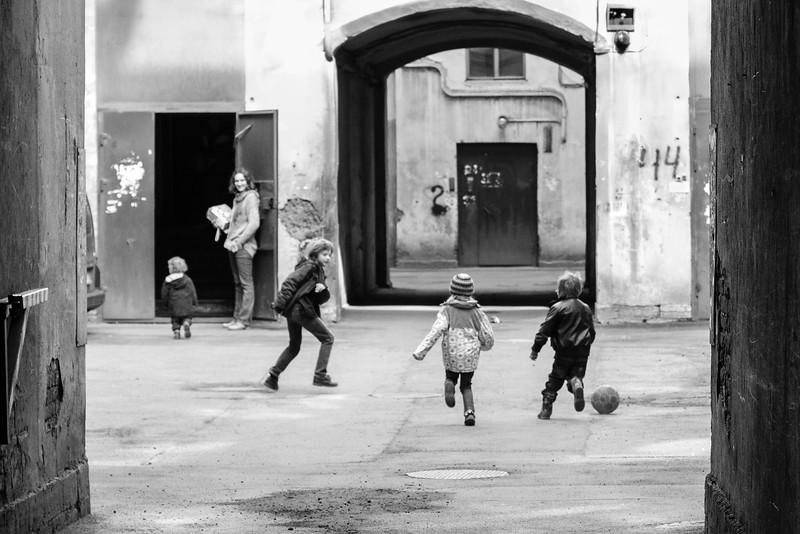 Playing kids on pathway yard