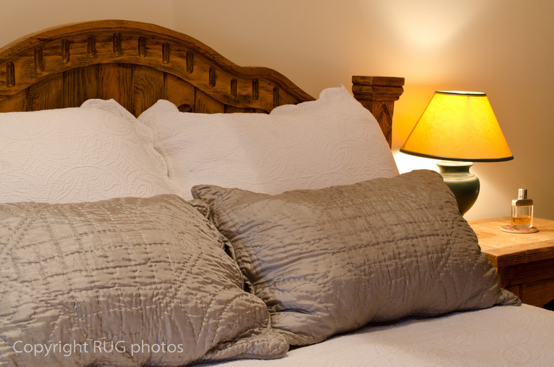 Plump pillows and 100% cotton sateen 400 thread count linens.