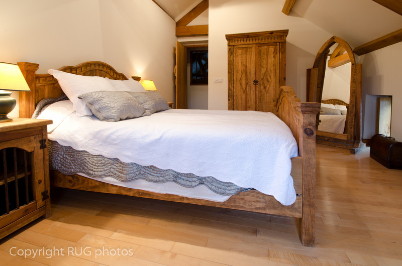 This bedroom had exposed oakbeams, cottage-style maple wood floor and a 5 foot wide antique pine bed.