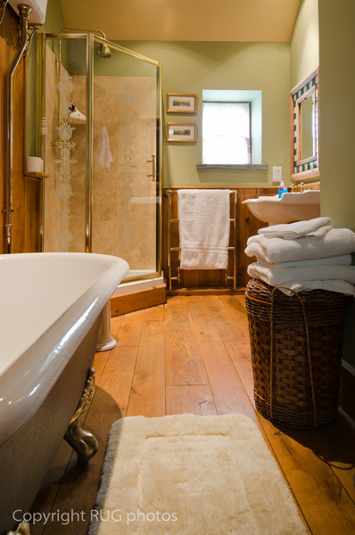The second bathroom was oak panneled and had a traditional cast iron roll top bath tub, a neo-angle corner shower and  quality traditionally styled Heritage porcelain fixtures including high cistern toilet and large washbasin.