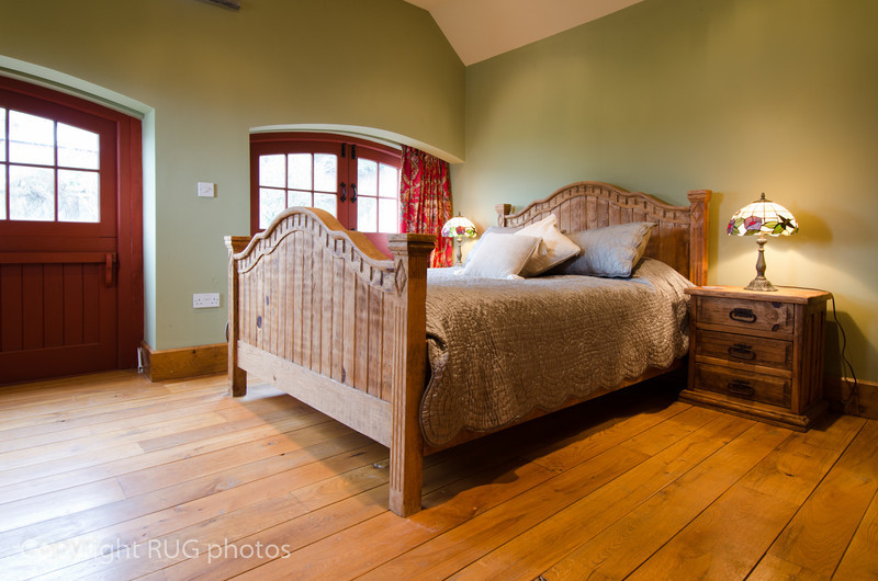 The second bedroom had burnished wide plank oak floor and a 5 foot wide antique style pine bed.