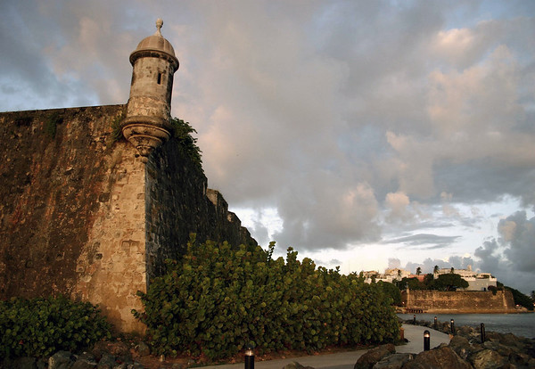 Garita on the City Wall - the wall is up to 40 ft. (12 m) high and 20 ft. (6 m) thick - La Fortaleza (Governor's Mansion) in the distance