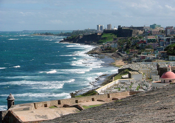 Across the fortress wall of El Morro - to Santa Maria Magdalena Cemetary, Old San Juan and the San Cristobal Fort - viewing eastward along the northeastern shoreline of Puerto Rico