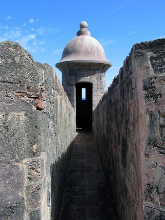 Through the window of a garita (sentry post) along the fortress wall of - Castillo de San Cristabol (St. Christopher Castle)
