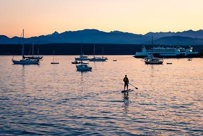 Paddle boarder at sunset, Port Townsend, Washington.