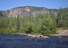 Malbaie River - source is Lake Malbaie, then it travels about 100 mi. (160 km) kilometres, winding its way through the Laurentian Mountains and discharges into the St. Lawrence River - here with a dead White Spruce lodged on the river boulders - Parc National des Hautes Gorges de la Riviere Malbaie (National Park of High Gorges of the Malbaie River) - Quebec