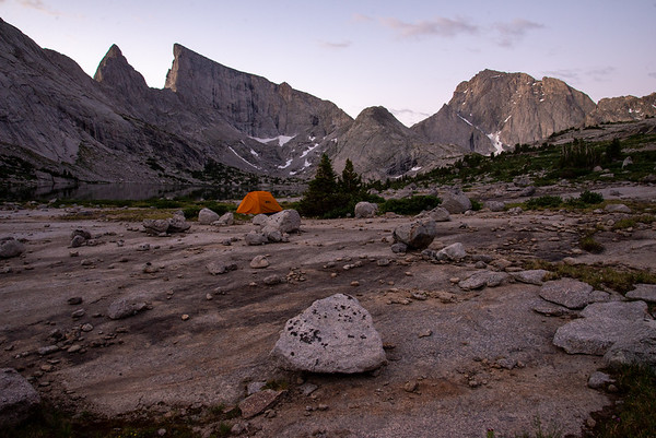 Dramatic granite walls stand above camp in the Wind River Range in Wyoming.