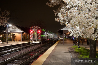 Northbound Metra stops at Lake Forest station on a beautiful clear night.