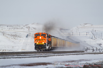 The long sweeping roller coaster hills of the Powder River Basin are some of my favorite to photograph. This clean unit can be seen powering up the next grade as it kicks up snow on its way out of the basin. Another train can be seen on the top of the hill and sometimes I will catch three or more trains here at once.