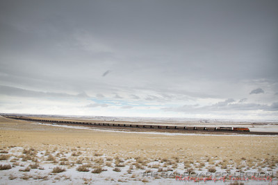 BNSF 6036 leads a coal train south across the snow covered Powder River Basin.