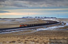 "BNSF 9223 snakes across the frozen Wyoming landscape with loaded hoppers of coal from the North Antelope Mine destined for Dairyland Power in Alma, Wisconsin.  Travis Dewitz <a href=""http://www.therailroadcollection.com/latest-works/"" target=""_blank"">The Railroad Collection</a>"