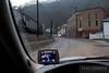 Driver seat view of the main drag through Keystone, West Virginia while a coal train rumbles through town.