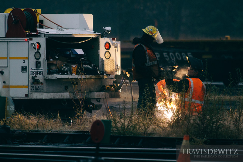 Track gang crews repair rail and do track work in the Union Pacific yard in Altoona, Wisconsin.