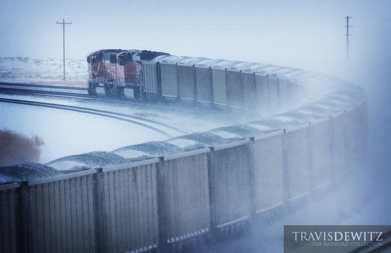 """Snow blows in the wind as a stiff cold wind blows across the Powder River Basin as more loads of coal heads out to power plants around the country to keep us warm.  Travis Dewitz <a href=""""http://www.therailroadcollection.com/latest-works/"""" target=""""_blank"""">The Railroad Collection</a>"""