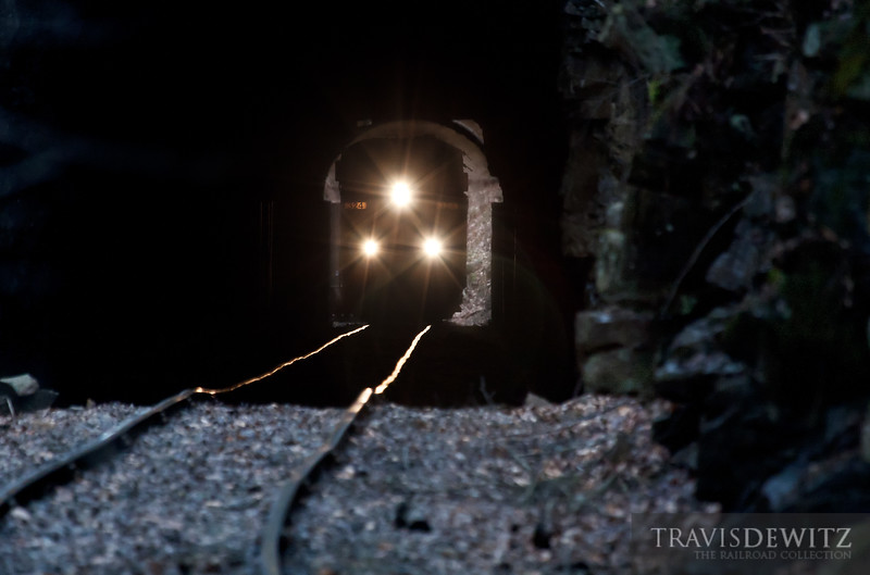 """A RJ Corman crew takes CSX power and empty coal hoppers up the hill to the Pax, West Virginia to the coal loadout. Here CSX 324 can be seen as it has just entered the Pax Tunnel.  Travis Dewitz <a href=""""http://www.therailroadcollection.com/latest-works/"""" target=""""_blank"""">The Railroad Collection</a>"""