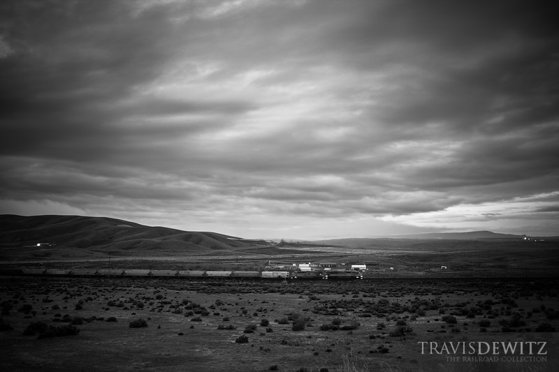 First light has yet to break the horizon as an Union Pacific train creeps west out of Rawlins, Wyoming.