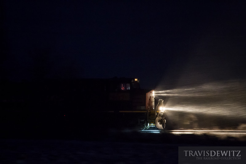 Union Pacific 6177 pulls a train of gondolas for frac sand service north on the Wisconsin Northern through the blowing snow near Eagleton, Wisconsin.