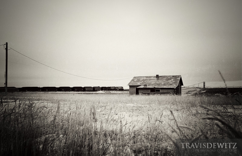"An abandoned homestead sits along the BNSF's Orin Subdivision near Reno Junction along Hilight Road. Another coal train makes its way south towards Black Thunder's coal tower which can be seen on the horizon.  Travis Dewitz <a href=""http://www.therailroadcollection.com/latest-works/"" target=""_blank"">The Railroad Collection</a>"