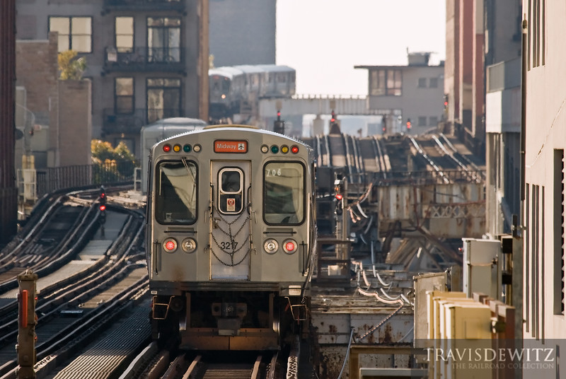 """The CTA's Midway train heads back into the downtown Chicago Loop.  Travis Dewitz <a href=""""http://www.therailroadcollection.com/latest-works/"""" target=""""_blank"""">The Railroad Collection</a>"""