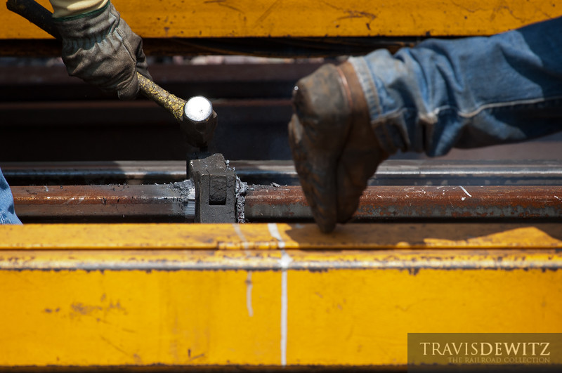 """A large Union Pacific hi-rail truck with an automated rail welder in back has just finished welding to long pieces of rail together and MOW workers now knock off the bracket and slag from the new joint.  Travis Dewitz <a href=""""http://www.therailroadcollection.com/latest-works/"""" target=""""_blank"""">The Railroad Collection</a>"""