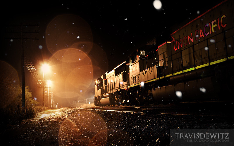 """Union Pacific MPRSS glides west out of Altoona yard, cutting through the falling snow on their way to Saint Paul, MN.  Travis Dewitz <a href=""""http://www.therailroadcollection.com/latest-works/"""" target=""""_blank"""">The Railroad Collection</a>"""