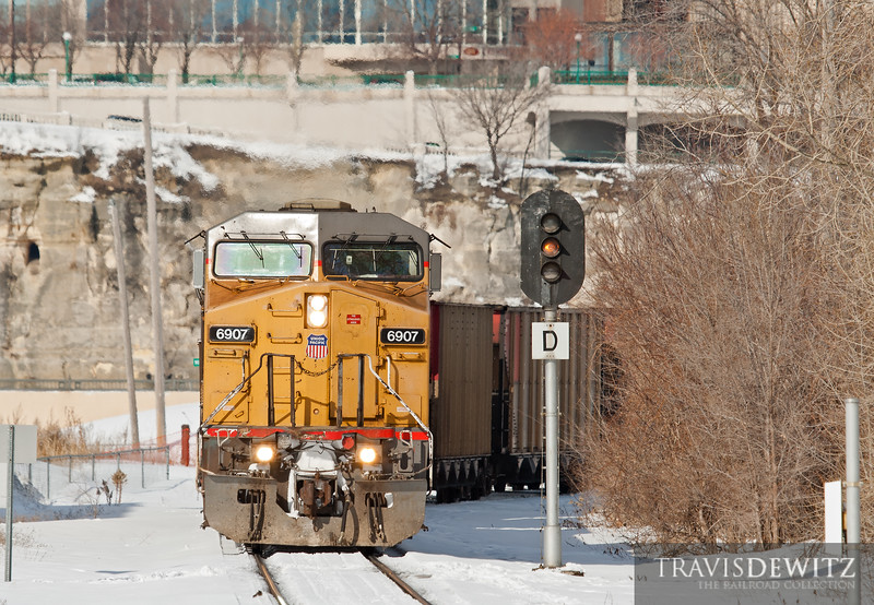 "Union Pacific 6907 has just crossed Robert Street bridge on this cold winter day.  Travis Dewitz <a href=""http://www.therailroadcollection.com/latest-works/"" target=""_blank"">The Railroad Collection</a>"