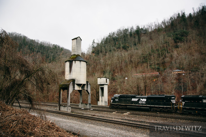 A Norfolk Southern coal waits at Farm near the old concrete coaling tower.