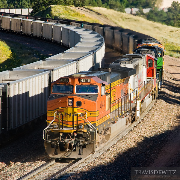 """A helper set out of Crawford, Nebraska pushes a loaded BNSF coal train up grade at Crawford Hill.  Travis Dewitz <a href=""""http://www.therailroadcollection.com/latest-works/"""" target=""""_blank"""">The Railroad Collection</a>"""
