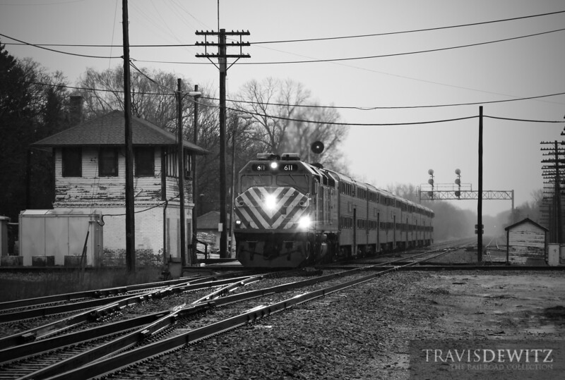 """Metra 611 is one of two remaining EMD F40Cs left in Metra's fleet. A steady rain falls at Rondout while a Metra Passenger train heads north out of Chicago one it's way to Fox Lake.  Travis Dewitz <a href=""""http://www.therailroadcollection.com/latest-works/"""" target=""""_blank"""">The Railroad Collection</a>"""