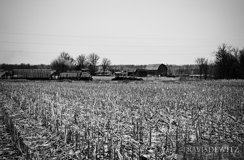 """Looks like a scene from the past as a Wisconsin Northern train  pulls hard on past a old farm homestead heading south near Tilden, Wisconsin.  Travis Dewitz <a href=""""http://www.therailroadcollection.com/latest-works/"""" target=""""_blank"""">The Railroad Collection</a>"""