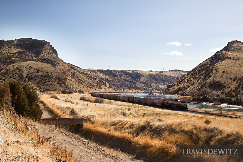 BNSF 9698 smokes as it leaves Lombard Canyon on the way west towards Toston, Montana.