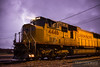Union Pacifc SD70M 4446 sits in front of the Altoona, Wisconsin yard office as a lightning strike flashes directly behind the unit.