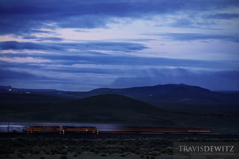 """The sun hasn't broke the surface of the Earth but trains on the Union Pacific near Rawlins, Wyoming are on the move.  Travis Dewitz <a href=""""http://www.therailroadcollection.com/latest-works/"""" target=""""_blank"""">The Railroad Collection</a>"""