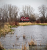 """A lone Wisconsin Southern EMD SD40-2 pulls a single gondola back from Solon Mill, Illinois back west to Janesville, Wisconsin as it glides past a pond just east of Zenda, Wisconsin.  Travis Dewitz <a href=""""http://www.therailroadcollection.com/latest-works/"""" target=""""_blank"""">The Railroad Collection</a>"""
