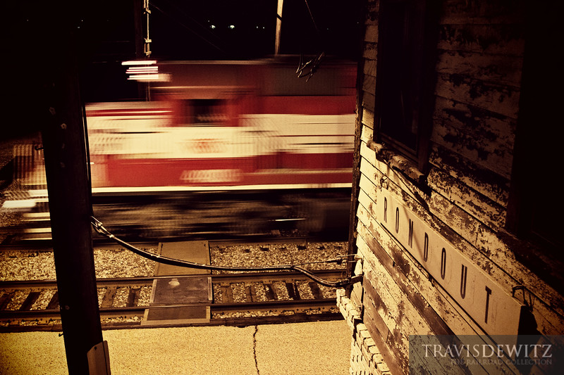 """The daily WSOR freight heads past Rondout tower and down towards Chicago.  Travis Dewitz <a href=""""http://www.therailroadcollection.com/latest-works/"""" target=""""_blank"""">The Railroad Collection</a>"""