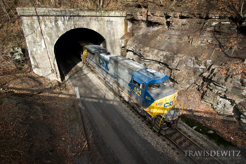 CSX 454 blasts out of Stretchers Neck Tunnel as it flies towards Prince, West Virginia.